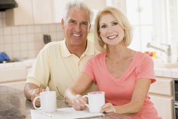 Couple savoring fresh from their espresso machine
